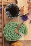 Festival moon cake - china dessert with green tea. Festival moon cake - china dessert with green tea Royalty Free Stock Photos