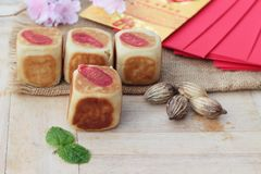 Festival moon cake with red envelopes, Chinese New Year. Royalty Free Stock Photos