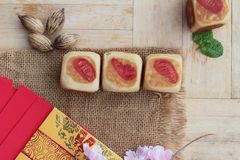 Festival moon cake with red envelopes, Chinese New Year. Royalty Free Stock Images
