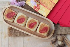 Festival moon cake with red envelopes, Chinese New Year. Stock Images