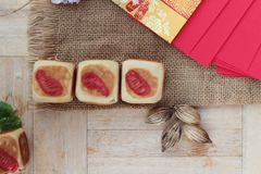 Festival moon cake with red envelopes, Chinese New Year. Royalty Free Stock Photo