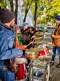 Festival music band. Friends playing on percussion instruments city park. Stock Photos