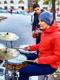 Festival music band. Friends playing on percussion instruments city outdoor. Royalty Free Stock Image