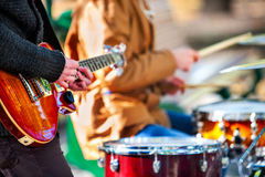 Festival music band. Friends playing on percussion instruments city park. Royalty Free Stock Images
