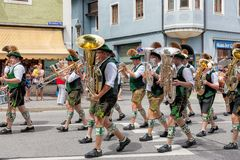 Festival with parade of fanfare and people in traditonal costumes royalty free stock image