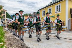 Festival with parade of fanfare and people in traditonal costumes royalty free stock images