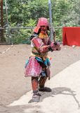 A festival participant in traditional samurai armor shows the art of naginata at the annual festival `Jerusalem Knights` stock image