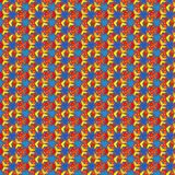 Festival pattern. colorful decorated repeating geometric pattern for celebrations designs. Repeating beautiful pattern in red, yellow and blue over a deep blue Royalty Free Stock Photography