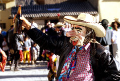 Festival- Peru. Majeno (drunken Conquistador) dancer in the Fiesta Pentecostes celebrations in the Incan village of Ollantaytambo (Sacred Valley), Peru Royalty Free Stock Photo