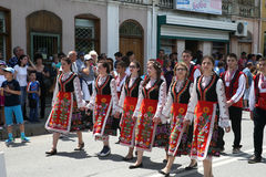 Young women are marching in national costumes. KAZANLAK, BULGARIA - JUNE 05, 2016: Young women are marching in national costumes. At the Rose Festival Royalty Free Stock Photos