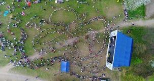 Festival scene and folk dances aerial stock video footage