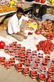 Festival Season - Mud lamp vendor. Mud lamp vendor selling beautiful lamps during diwali festival in india stock photo
