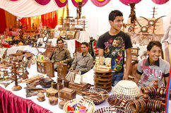 Festival Season - Woodcraft shop. Happy shopkeepers displaying woodcraft items during diwali festival in india Royalty Free Stock Image