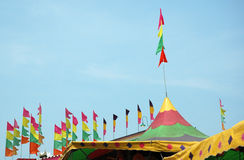 Festival Tent Tops. Colorful peaked festival tent tops with flags royalty free stock photography