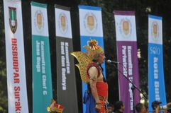 Festival to celebrates the World Day Tourism in Indonesia. A tourism activists uses traditional puppet costumes during the festival to celebrates the World Day Royalty Free Stock Photo