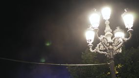 Festival in Toledo, Spain, close up of a street lamp at night. Close up of a vintage street lamp shining brightly at night on a festival in Toledo, Spain stock video footage