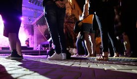 Assistants next to music stage at FiraB festival in Mallorca. Festivalgoers attend a Rock festival in the FiraB arts and music festival in Palma de Mallorca stock photos