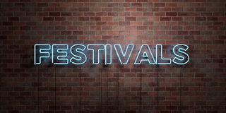 FESTIVALS - fluorescent Neon tube Sign on brickwork - Front view - 3D rendered royalty free stock picture. Can be used for online banner ads and direct mailers Royalty Free Stock Photography