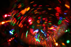 Festive abstract. Festive mini lights as reflected and seen through a wine glass from below Royalty Free Stock Photo