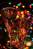 Festive abstract. Crystal glasses, sparkling wine, festive lights....celebrate Royalty Free Stock Image