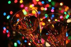 Festive abstract. Crystal glasses, sparkling wine, festive lights....celebrate Stock Image