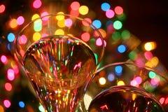 Festive abstract. Crystal glasses, sparkling wine, festive lights....celebrate! brighter version Stock Images