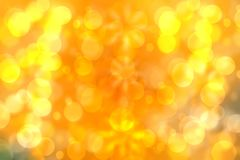 A festive abstract golden yellow gradient background texture with glitter defocused sparkle bokeh circles. Card concept for Happy stock photo