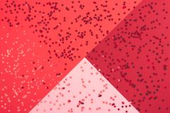 Festive abstract red background with metallic confetti. royalty free stock photo