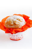 Festive almond Muffin with red wrap Royalty Free Stock Photos
