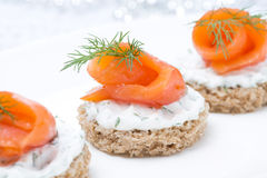 Festive appetizer - canape with rye bread, cream cheese, salmon Stock Photos