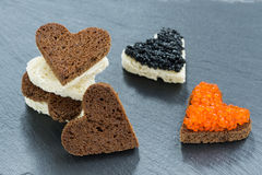 Festive appetizer - toast with red and black caviar, closeup Stock Image