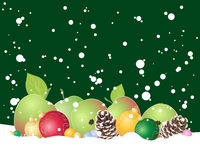 Festive apples. An illustration of an arrangement of apples baubles and pine cones in snow with snowflakes on a dark green background Stock Photos