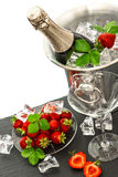 Festive arrangement with bottle of champagne and strawberries Royalty Free Stock Photo