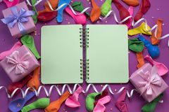 Festive arrangement Gifts Balloons Streamers Notebook Saturation of the background Ultraviolet. Top View flat lay stock images