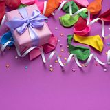 Festive arrangement Gifts Balloons Streamers Notebook Saturation of the background Ultraviolet. Top View flat lay royalty free stock photography