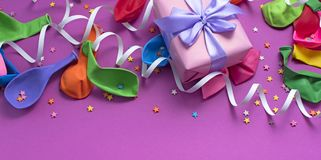 Festive arrangement Gifts Balloons Streamers Notebook Saturation of the background Ultraviolet. Top View flat lay royalty free stock photo