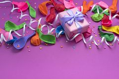 Festive arrangement Gifts Balloons Streamers Notebook Saturation of the background Ultraviolet. Top View flat lay stock image