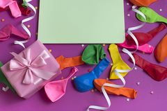 Festive arrangement Gifts Balloons Streamers Notebook Saturation of the background Ultraviolet. Top View flat lay royalty free stock images