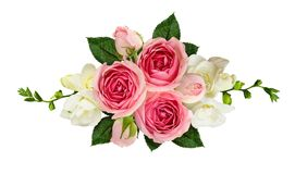 Festive arrangement with pink roses and freesia flowers. Horizontal arrangement with pink roses and freesia flowers isolated on white. Top view. Flat lay Stock Image