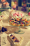 Festive arrangement with sweets and bead Royalty Free Stock Photo