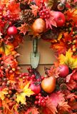 Festive autumn wreath. On rustic door stock photos