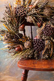 Festive autumn wreath with acorns and fall leaves stock images