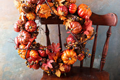 Festive autumn wreath with pumpkin and fall leaves stock images