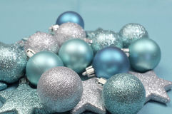 Festive background of aqua pale blue christmas glitter baubles - selective focus Stock Photo