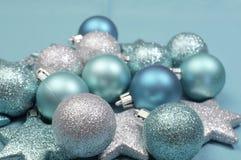 Festive background of aqua pale blue christmas glitter baubles - selective focus. Festive background of aqua turquoise pale blue christmas glitter baubles and Stock Photo