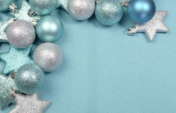Festive background of aqua pale blue christmas glitter baubles w' copy space. Festive background of aqua turquoise pale blue christmas glitter baubles and stars Royalty Free Stock Photography