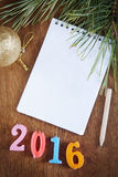 Festive background with blank notepad about Happy New Year Stock Photo