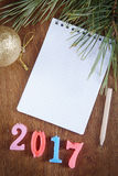 Festive background with blank notepad about Happy New Year 2017 Stock Photo