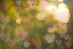 Festive background with bokeh heart-shaped, multi-colored. Caused by natural light Stock Image