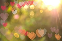 Festive background with bokeh heart-shaped, multi-colored. Caused by natural light is Bright orange light Stock Photo